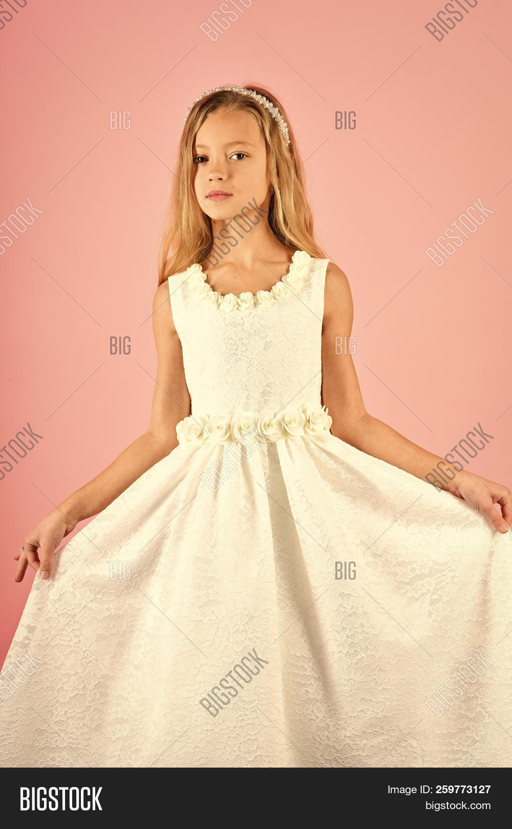 7a984cb43668 Child girl in stylish glamour dress, elegance. Look, hairdresser, makeup.  Fashion and beauty, little princess. Little girl in fashionable dress, prom.