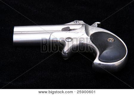 Circa 1889, Model 95, Type II Model 3 Double Derringer on black velvet