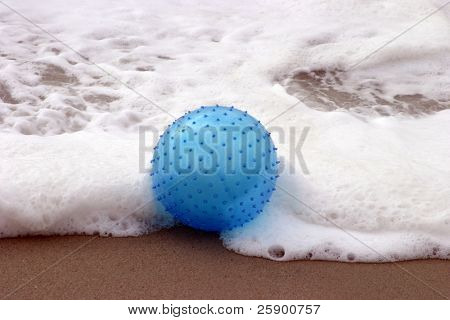 spikey blue beach ball in ocean waves