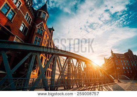 Metal Arch Bridge And Old Red Bricks Building In The Speicherstadt Warehouse District Of Hamburg Haf