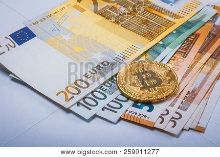 Cash Euro With A Face Value Of One Hundred And Two Hundred And Fifty Close-up With A Crypto Currency