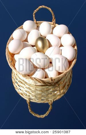 basket of white eggs with One Golden Egg on a mirror with blue sky background