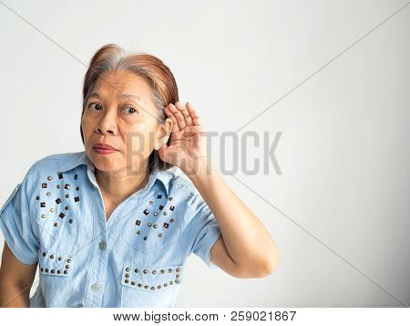 Senior Elderly Asian Women Want To Hear Something From Someone In White Background Maybe She Have A
