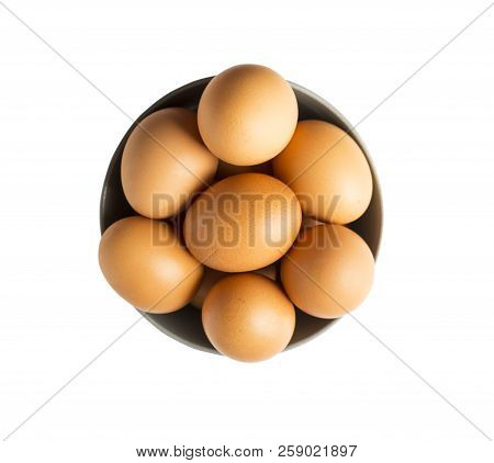 Eggs Isolated On White Background. Eggs Isolated In Wooden Bowl . Close-up Of An Egg Isolated On Whi