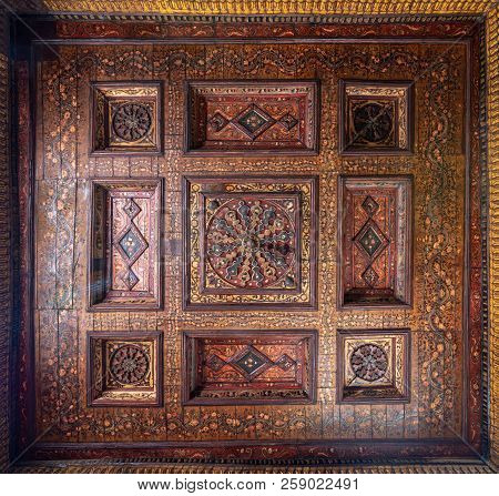 Cairo, Egypt - September 15 2018: Ottoman Era Decorated Wooden Ceiling With Golden Floral Pattern De