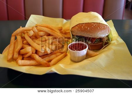 a lunch consisting of a Beacon Cheese Burger and Freedom Fries in a Drive In Diner with Ketchup