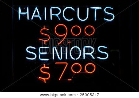"neon sign series ""haircuts $9.00, seniors $7.00"" poster"