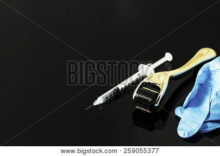 Derma roller for medical micro needling therapy. Tool also known as: Derma roller, mesoroller, meso-roller, mesopen. poster