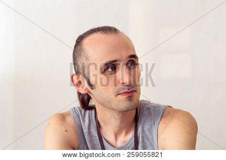 Brunet Man With Stylish Hair Thinking And Looking Sideways On White Background