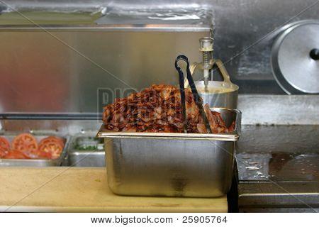Hot Fresh Fried Bacon piled high in a pan in a Hamburger Restaurant