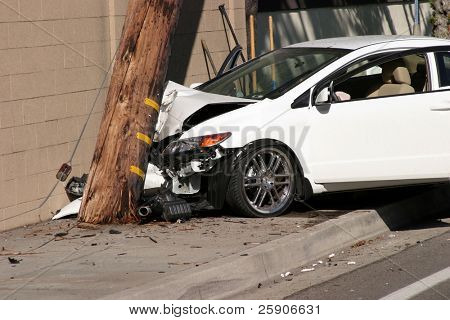 a car accident where the car sheers a 95 foot utility pole off at ground level and moves it 20 feet forward snapping it in two parts