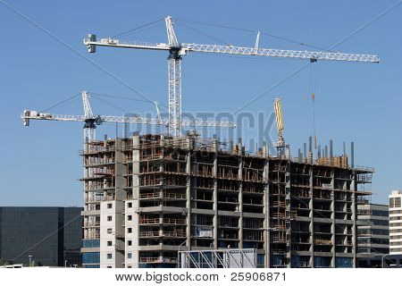 building construction with cranes
