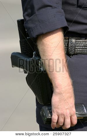 a close up of a police man holding his radio