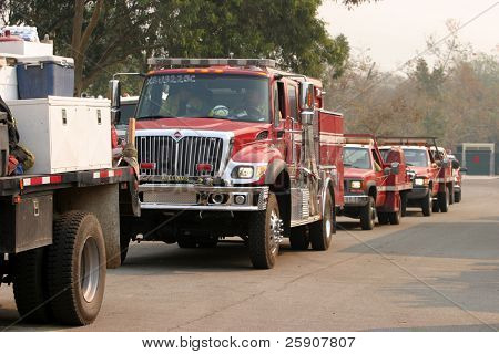 fire trucks line up for gas and diesel fuel and prepair to go battle the wild fires from the santiago canyon staging area