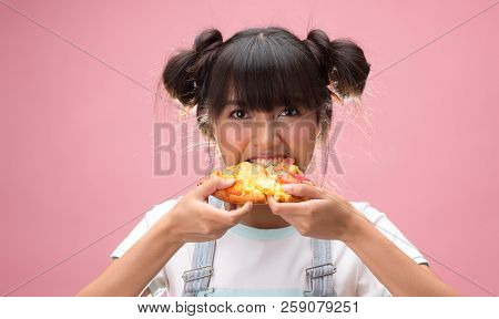 Happy Young Asian Woman Eating Slice Of Pizza, On Pink Background