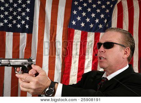 a Secret Service Agent points his weapon at a suspect