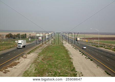 "Various Trucks and Cars cruise down ""Interstate 5"" freeway in central california usa at a speed of ""70 mph"" poster"