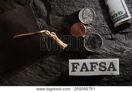Fafsa (free Application For Federal Student Aid) Text With Graduation Cap And Money -- Financial Aid