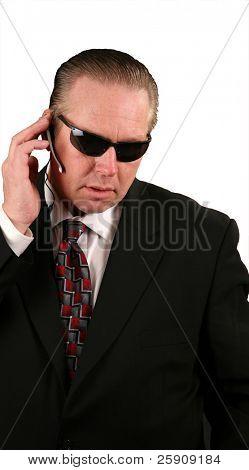 a Secret Service Agent talks into his microphone