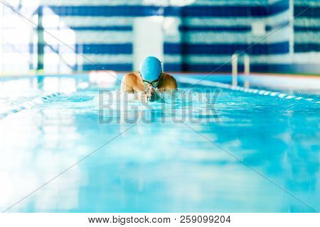 Image of sportive man swimming in pool