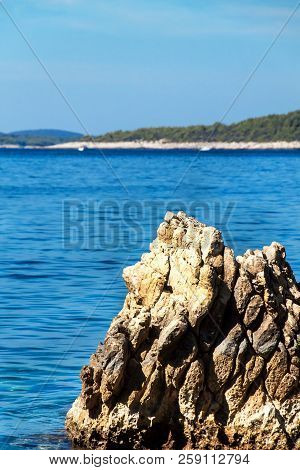 Croatian rocky coastline. Coast of Hvar Island. Greetings from the sea. Sea and rocks in Croatia. Vacation at sea. Quiet place poster