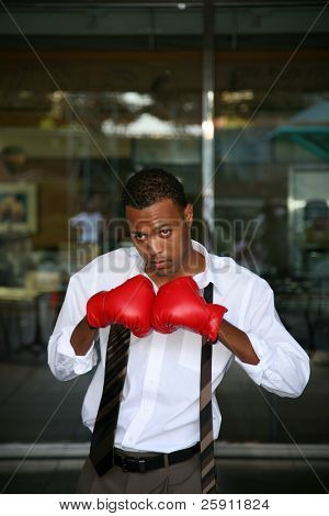 a young boxer poses with his boxing gloves for the press before the big fight