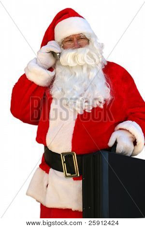 Santa Claus Holds a briefcase and talks on his cell phone isolated on white