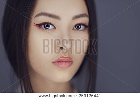 Serious Asian Beauty Woman Skin Care Close-up. Beautiful Young Girl With Perfect Skin Face Looking A