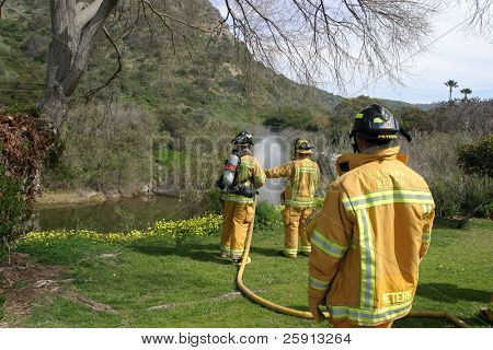 LAGUNA BEACH, CA - FEB 19: Firefighter recruits practice fire fighting drills at the local Fire Department training area on February 19, 2009 in Laguna Beach, California.