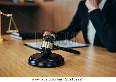 Judge Gavel With Justice Lawyers, Businesswoman In Suit Or Lawyer Working On A Documents. Legal Law,