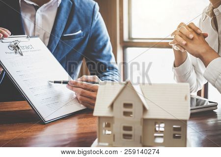 Real Estate Broker Agent Presenting And Consult To Customer To Decision Making Sign Insurance Form A