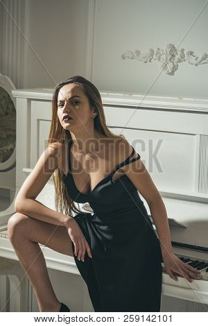 Sexy Woman Waiting For Inspiration At Piano. Music Is Source Of Inspiration.