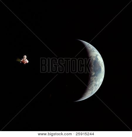 """Fifi the Bichon Frise takes a trip into outerspace in her Rocket Car, in a NASA """"outerspace photo"""" featuring the earths moon"""