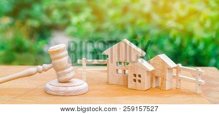 Houses / Real Estate And A Hammer Of The Judge. Court And Division Of Property. Concept Of Law And L