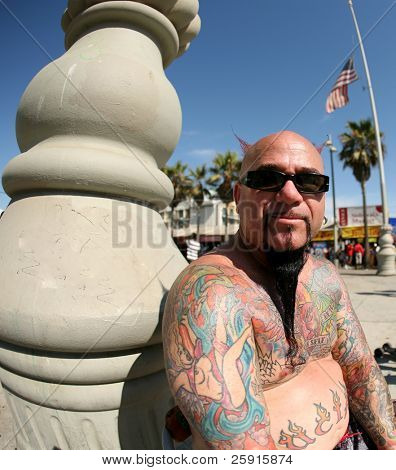 a colorful tattoo artist enjoys a summer day outside