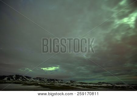 The Green Skies Above The Mountains In Iceland