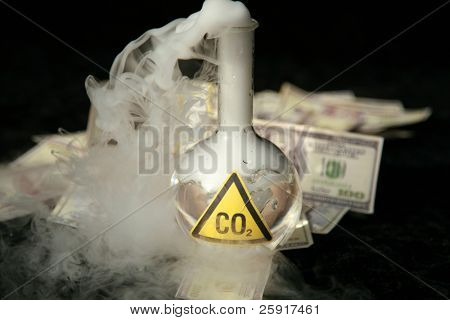a 500ml beaker filled with CO2 infront of a pile of money, representing the business interest behind the Global Warming scare poster