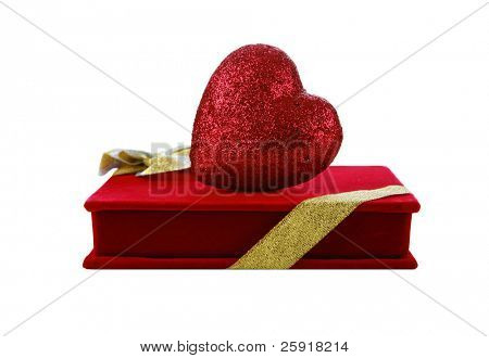 a red velvet box of chocolates with a red heart, isolated on white with room for your text or images. Perfect for Valentines Day