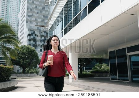 Businesswoman Talking On Cell Phone And Commuting