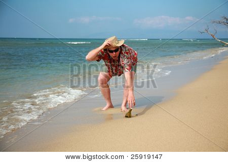 "a happy tourist finds a ""Message in a bottle"" washed ashore while visiting Maui Hawaii poster"