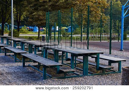 Tables For Rest In A Public Park. Outdoor Park Equipment. Rest Zone In The Park. City Park On A Summ