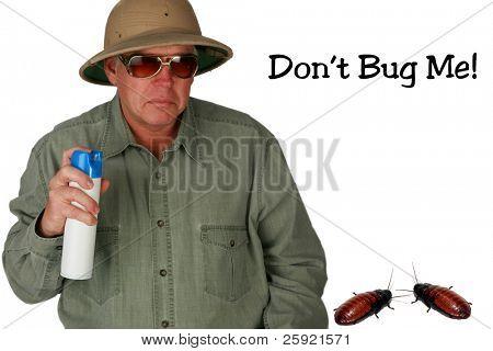 a man in a pith helmet sprays Bug Spray towards a giant cockroach with
