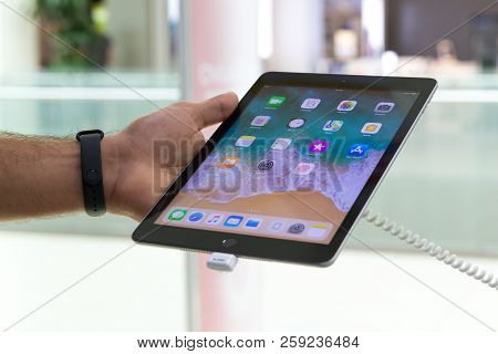 Belgrade, Serbia - September 13, 2018: New Apple Ipad Mini Is Displayed With Home Screen In Hand. Ta