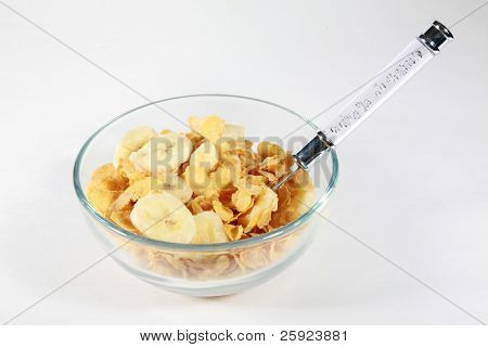 Bowl of corn flakes with milk and banana
