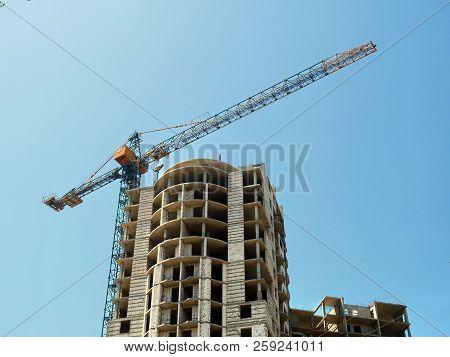 Construction Of A Multi-storey Building. Crane Near Building. Construction Of A High-rise Building.