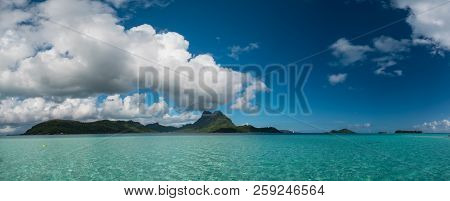 Panoramic View Of Vaitape, Blue Lagoon, White Sandy Beach And Otemanu Mountain At Bora Bora Island,