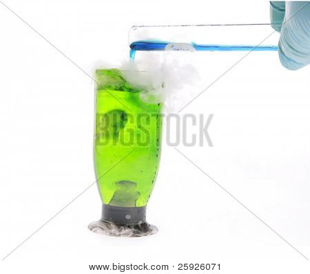 a scientist or chemist adds chemicals to a beaker of fluids for a violent chemical reaction. isolated on white