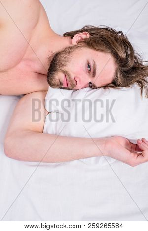Man Unshaven Handsome Guy Naked Torso Relaxing Bed Top View. Guy Sexy Macho Lay White Bedclothes. Ma