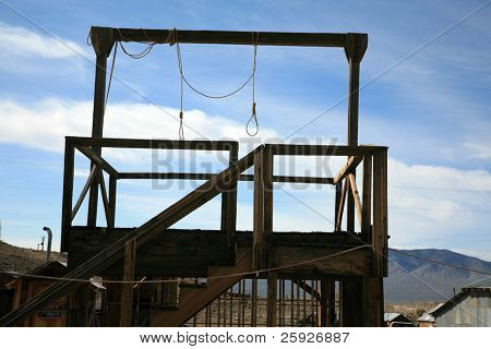 a gallows in a real ghost town in nevada usa with two nooses bringing to light the reality of Swift Justice from the Wild Wild West poster