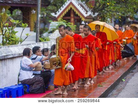 Luang Prabang , Laos - Aug 11 2018 : Buddhist Alms Giving Ceremony In Luang Prabang Laos On August 1